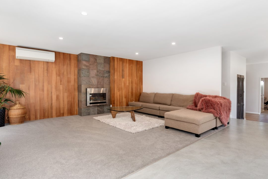 Timber feature wall around gas fire Oceanbeach road